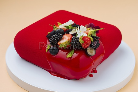 red cake with fresh berries