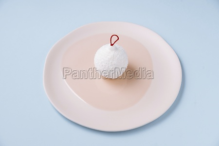 bauble shaped coconut dessert on plate