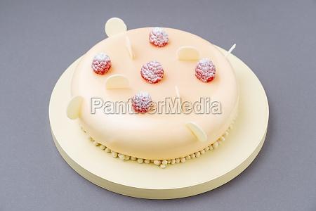cake with fresh raspberries and white