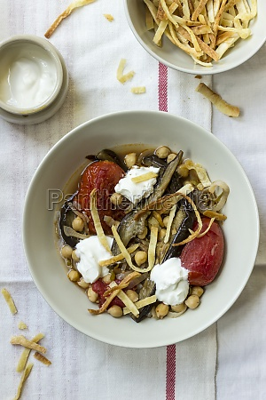 baked aubergine tomatoes with chickpeas served
