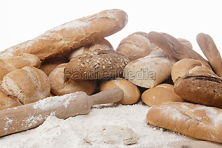wooden rolling pin and heap of