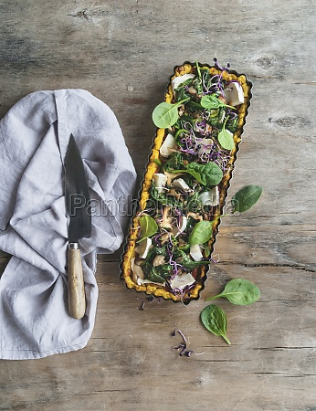 polenta tart with mushrooms spinach leaves