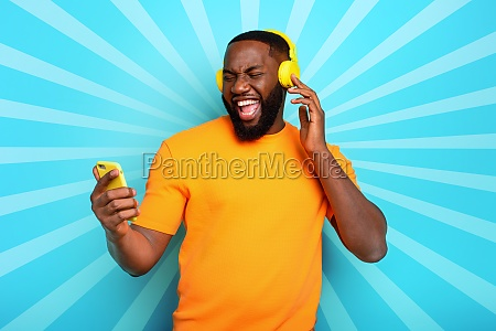 boy with yellow headset listens to