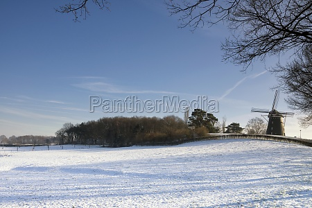 windmill in a snowcovered landscape near