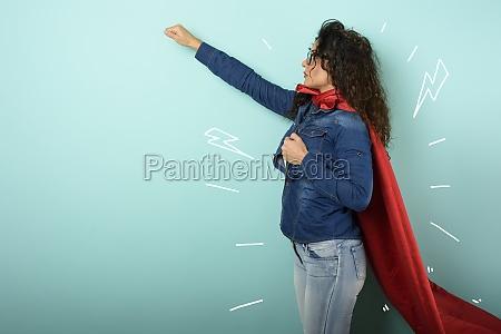 woman acts like a superhero concept