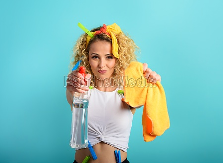 blonde housewife splashs disinfectant to remove