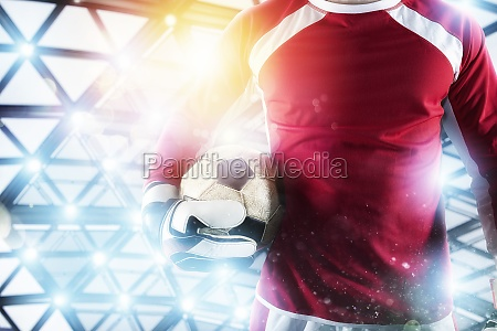 goalkeeper holds the ball in the