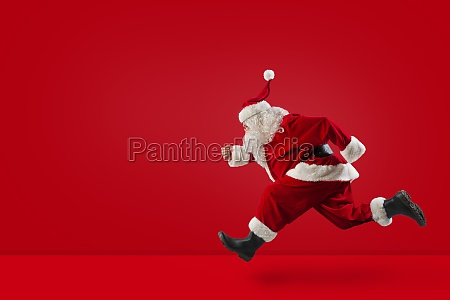 santa claus runs fast on red