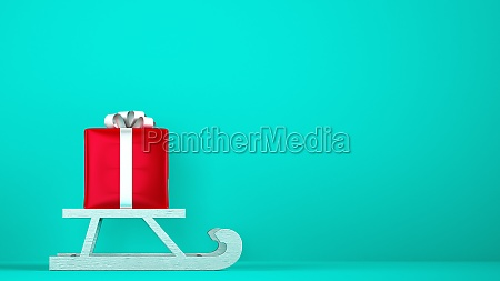 red gift package on christmas sleigh