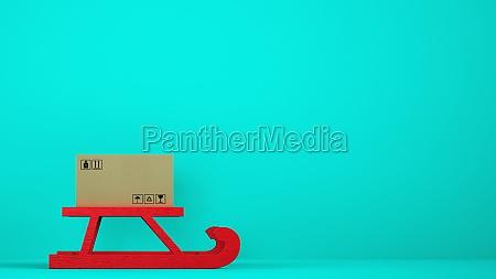 cardboard box on red christmas sleigh