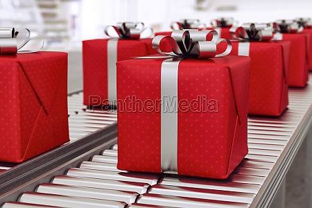 christmas gift boxes on conveyor rollers