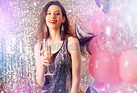 girl drinks sparkling wine to celebrate