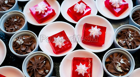 red jelly dessert with whipped cream