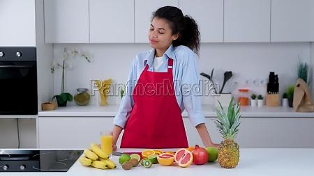 woman prepares a fruit juice full