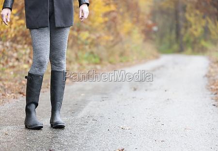 detail woman wearing black wellingtons