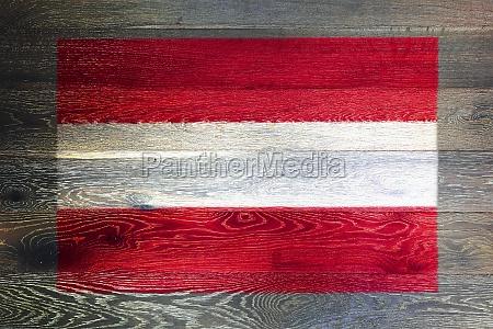 austria flag on rustic old wood