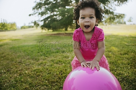 black girl playing with ball in