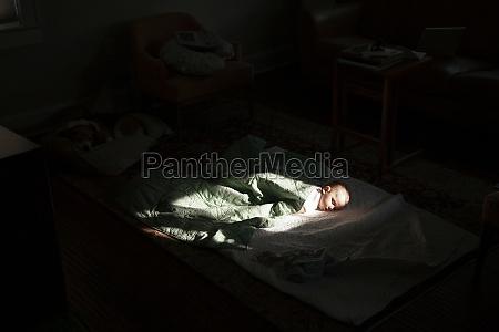 baby boy sleeping in sunspot in