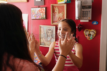 girls playing hand clapping game at
