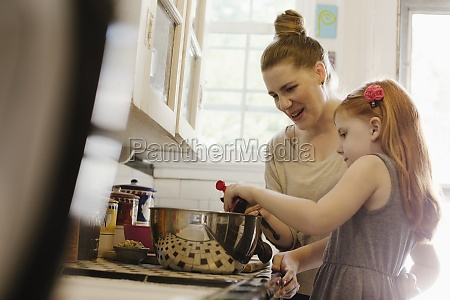 mid adult mother giving daughter a
