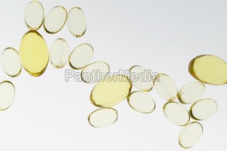 fish oil pills on white background