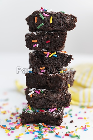 stack of freshly baked brownies covered