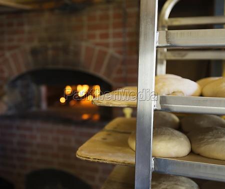 artisan bread on shelves in kitchen