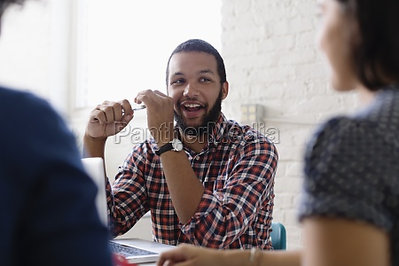 people in a meeting in small
