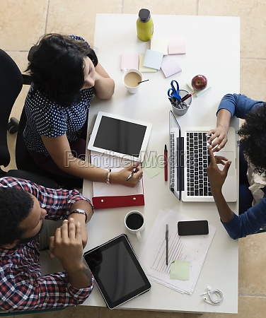 colleagues having meeting in small business