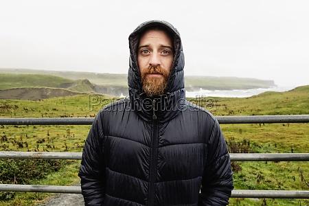mid adult man wearing winter coat