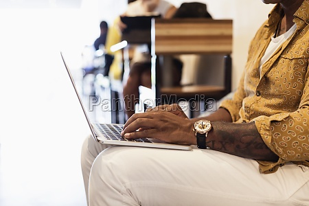 young man in coffee shop using