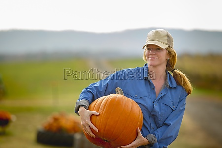 united states virginia woman harvesting pumpkins