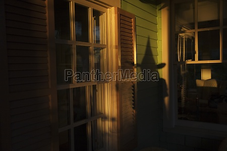 shadow of witch on house at