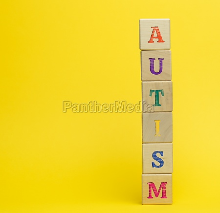 wooden cubes with the inscription autism