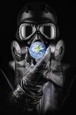 menacing entity wearing fallout gas mask