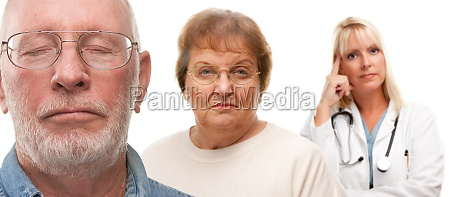 concerned senior couple and female doctor