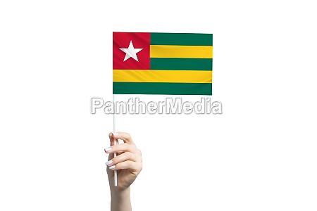 beautiful female hand holding togo flag