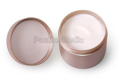 metal jar with white cream