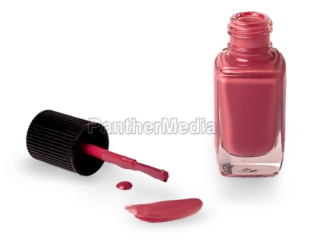 red nail varnish with a brush