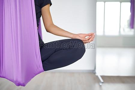 aerial yoga woman on hammock meditation