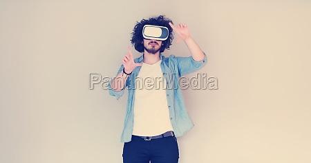 man using headset of virtual reality