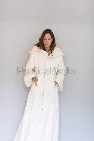 woman in a white coat with