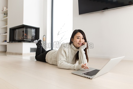 young asian woman using laptop on