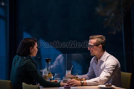 loving couple enjoying romantic dinner