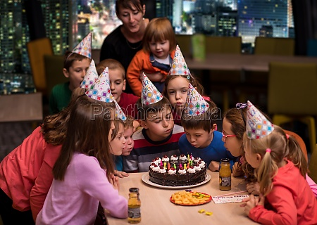 happy young boy having birthday party
