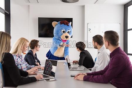 boss dresed as bear having fun