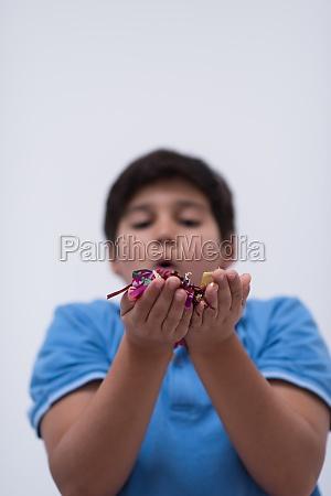 kid blowing confetti