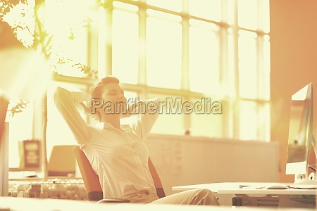 young business woman relaxing at workplace