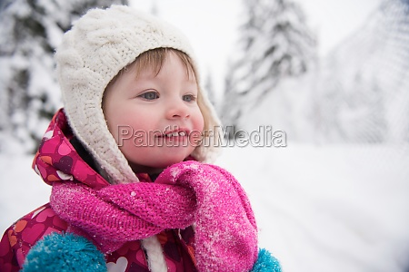 little girl have fun at snowy