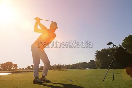 golf player hitting shot with club